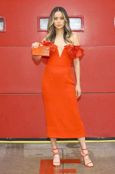 PHOTO: Actress Jamie Chung is seen in her award show look for the 27th Annual Screen Actors Guild Awards on March 31, 2021 in New York City. Chung holds a sign that reads 'Stop Asian Hate.' (Dimitrios Kambouris/Getty Images)