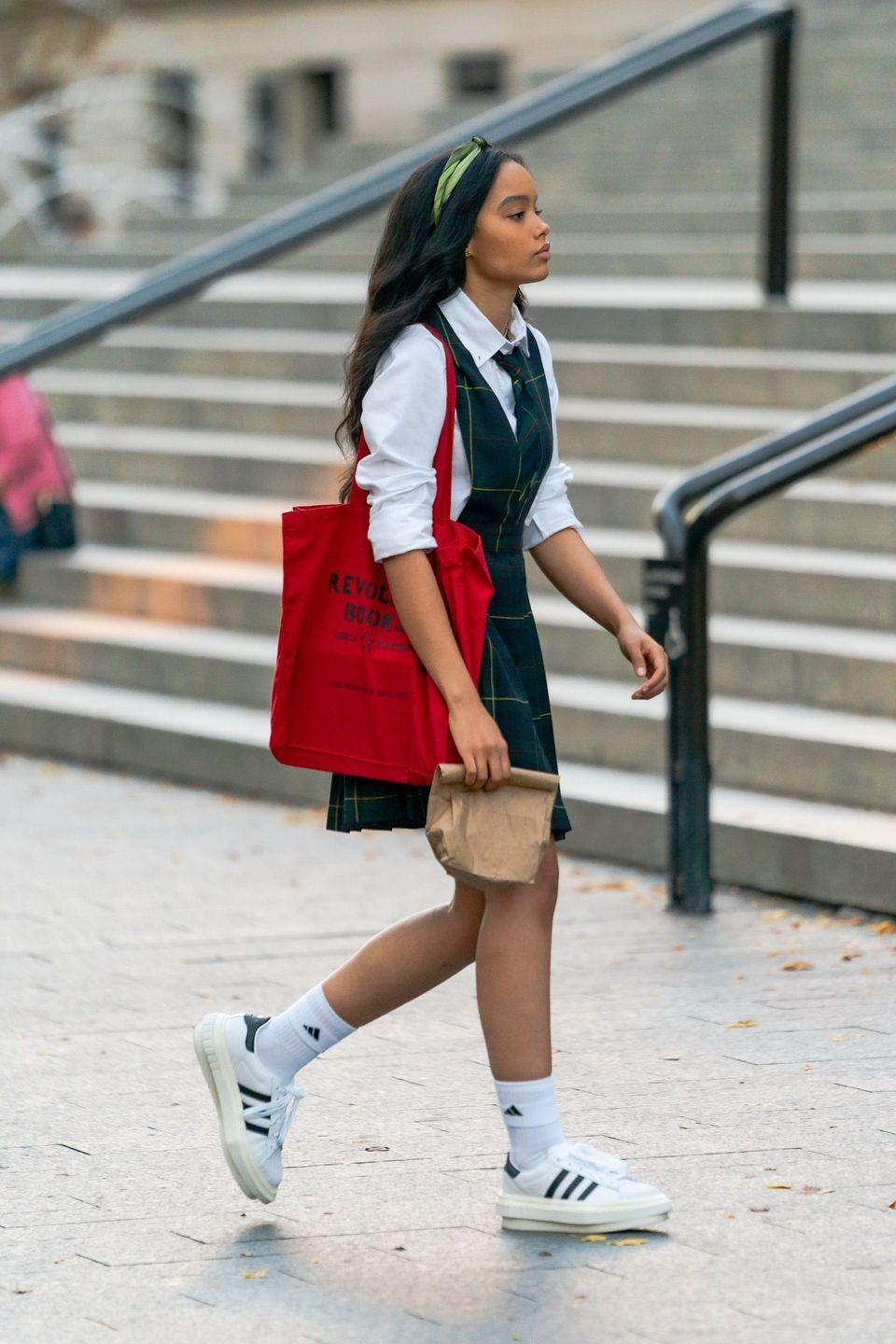<p>Whitney Peak carries a red tote bag and packed lunch. </p>