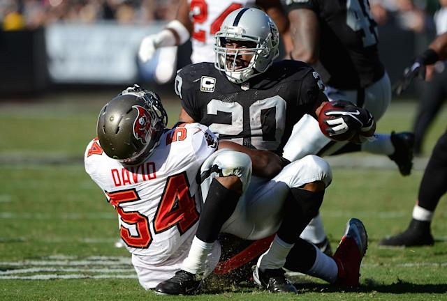 OAKLAND, CA - NOVEMBER 04: Darren McFadden #20 of the Oakland Raiders gets wrapped up by Lavonte David #54 of the Tampa Bay Buccaneers during the second quarter of their NFL football game at O.co Coliseum on November 4, 2012 in Oakland, California. (Photo by Thearon W. Henderson/Getty Images)
