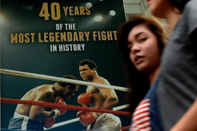 "A poster in Manila celebrates the legendary ""Thrilla in Manila"" boxing match between Muhammad Ali and Joe Frazier in 1975 (AFP Photo/Noel Celis)"