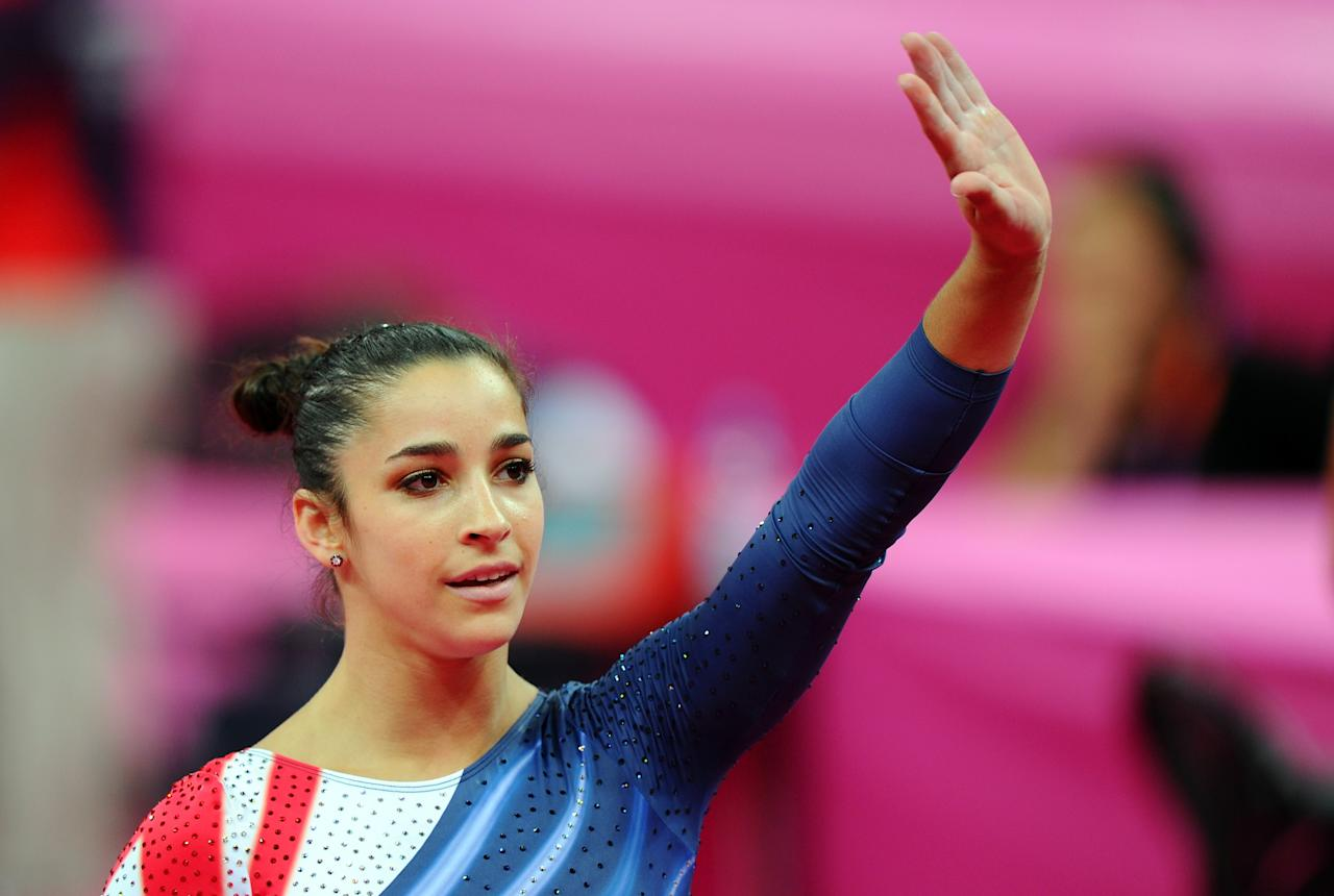 Alexandra Raisman of the United States waves to the crowd after winning the gold medal for the Artistic Gymnastics Women's Beam final on Day 11 of the London 2012 Olympic Games at North Greenwich Arena on August 7, 2012 in London, England.  (Photo by Michael Regan/Getty Images)