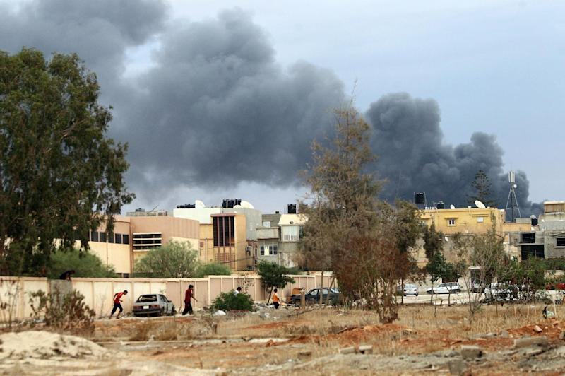 Smoke billows from buildings reported to be used for storing ammunition belonging to Benghazi-based Islamist Ansar al-Sharia group, after being pounded by the Libyan airforce, loyal to former general Khalifa Haftar, October 22, 2014