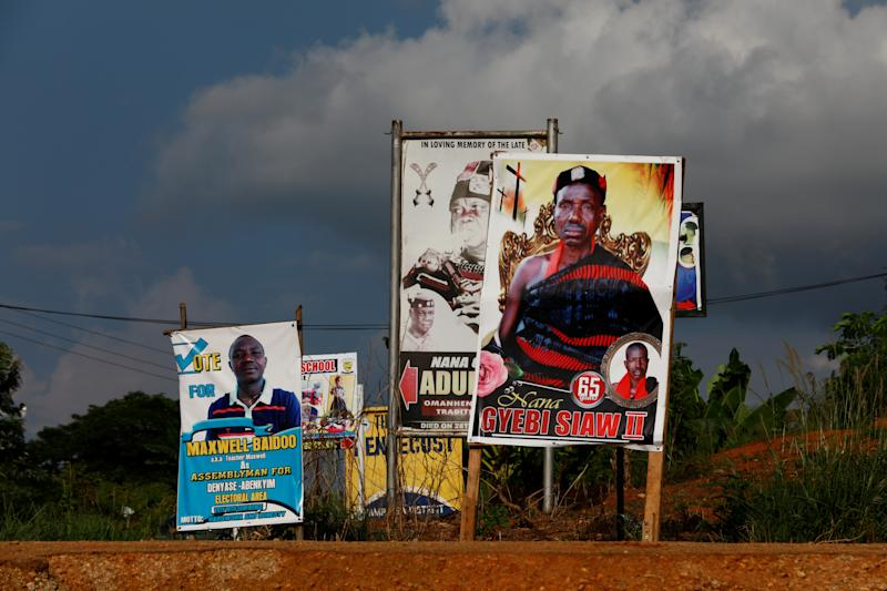 Obituaries and political posters along a road in Denyase, Ashanti region, Ghana. (Photo: Francis Kokoroko/Reuters)