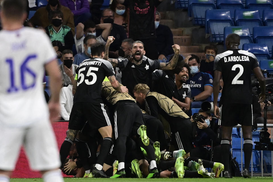 Sheriff's players celebrate their second goal during the UEFA Champions League first round group D footbal match between Real Madrid and Sheriff Tiraspol at the Santiago Bernabeu stadium in Madrid, on September 28, 2021. (Photo by JAVIER SORIANO / AFP) (Photo by JAVIER SORIANO/AFP via Getty Images)