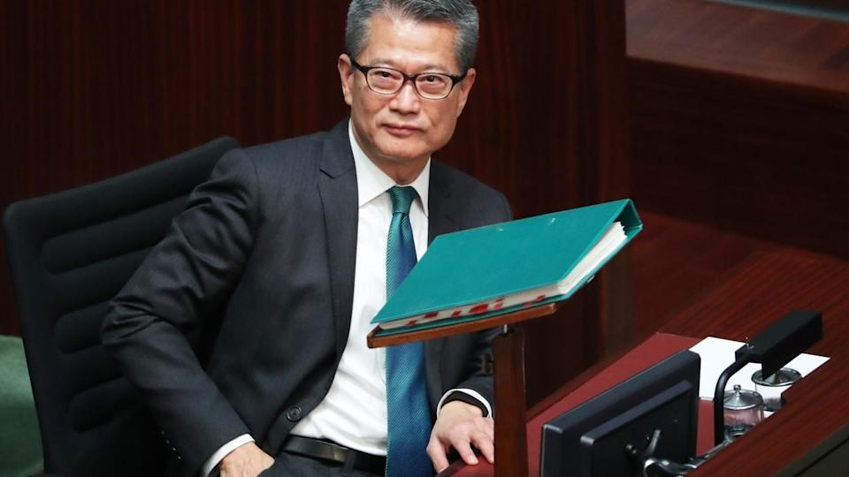 Hong Kong's finance minister offers HK$150 billion in targeted spending on health, welfare and IT