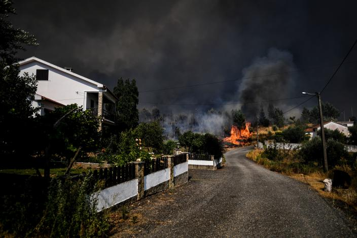 A wildfire approaches a house at Casas da Ribeira village in Macao, central Portugal on July 21, 2019. (Photo: Patricia De Melo Moreira/AFP/Getty Images)
