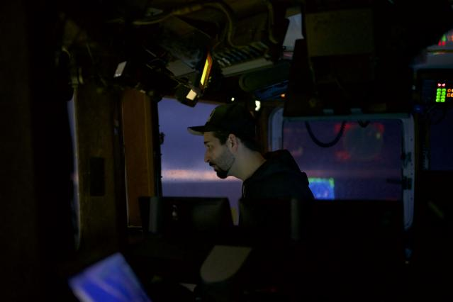 Josh Harris in the wheelhouse of the <em>Cornelia Marie</em>. (Photo: Discovery)