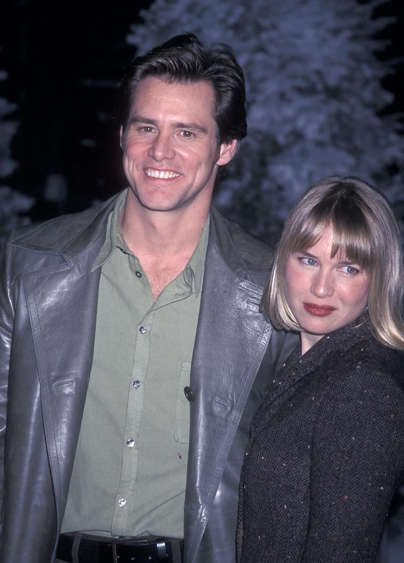 """UNIVERSAL CITY, CA - NOVEMBER 8: Actor Jim Carrey and actress Renee Zellweger attend """"The Grinch"""" Universal City Premiere on November 8, 2000 at the Universal Amphitheatre in Universal City, California. (Photo by Ron Galella, Ltd./Ron Galella Collection via Getty Images)"""