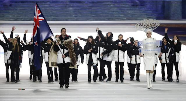 Shane Dobbin of New Zealand carries the national flag as he leads the team during the opening ceremony of the 2014 Winter Olympics in Sochi, Russia, Friday, Feb. 7, 2014. (AP Photo/Mark Humphrey)