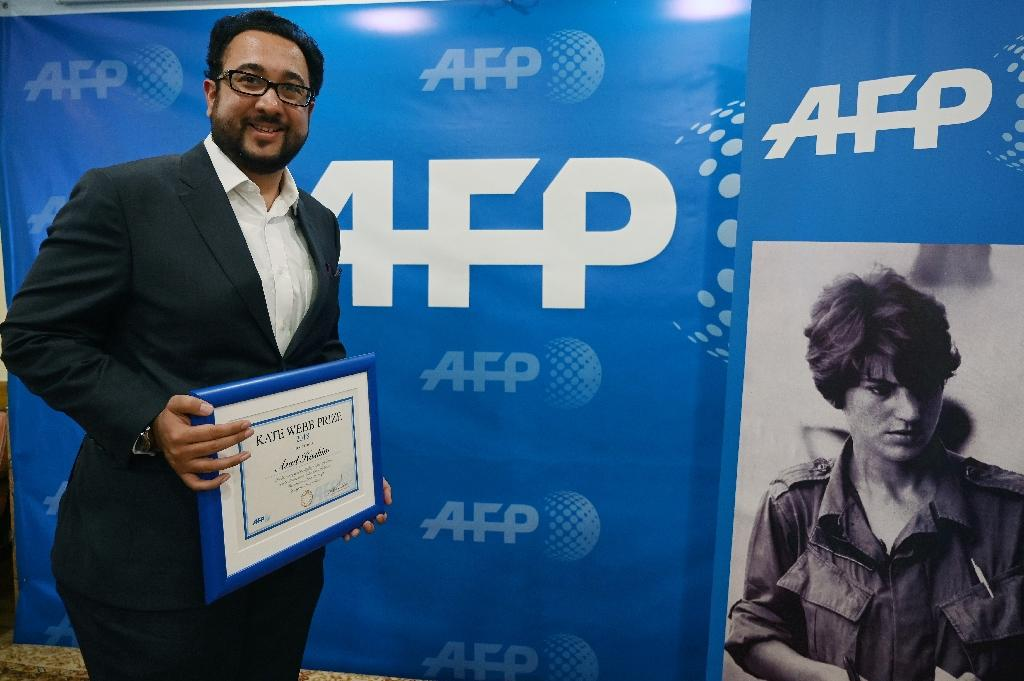 Asad Hashim, 33, was honoured for an illuminating series of articles on ethnic Pashtuns and other minority groups caught in the crossfire of Pakistan's bloody battle against militants (AFP Photo/AAMIR QURESHI)