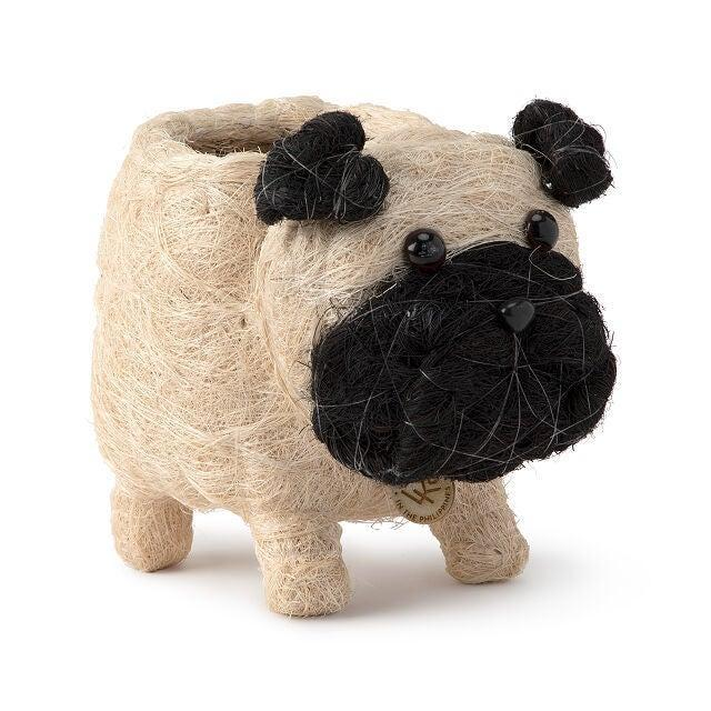 """<h2>Uncommon Goods Coconut Fiber Pug Planter</h2><br>A cute and tiny pug planter...but make it sustainable! This adorable planter is made from eco-friendly coconut fibers, wicker, and string. Pair this cute pug pot with a cute plant and gaze at it in adorable awe.<br><br><em>Shop </em><a href=""""http://uncommongoods.com/"""" rel=""""nofollow noopener"""" target=""""_blank"""" data-ylk=""""slk:Uncommon Goods"""" class=""""link rapid-noclick-resp""""><em><strong>Uncommon Goods</strong></em></a><em><br></em><br><br><strong>Uncommon Goods</strong> Dog Planter, $, available at <a href=""""https://go.skimresources.com/?id=30283X879131&url=https%3A%2F%2Fwww.uncommongoods.com%2Fproduct%2Fcoconut-fiber-dog-planter%23520260000001"""" rel=""""nofollow noopener"""" target=""""_blank"""" data-ylk=""""slk:Uncommon Goods"""" class=""""link rapid-noclick-resp"""">Uncommon Goods</a>"""