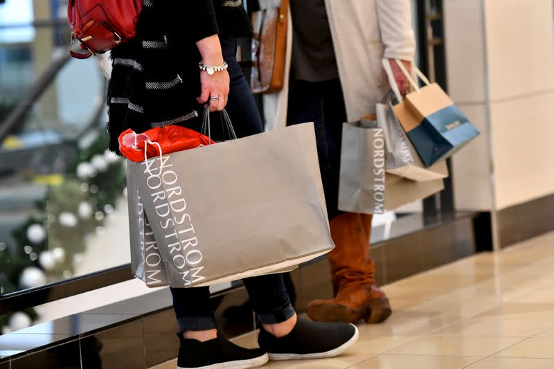 FILE PHOTO: Shoppers clutch their Nordstrom bags at an Old Navy store as holiday shopping accelerates at the King of Prussia Mall