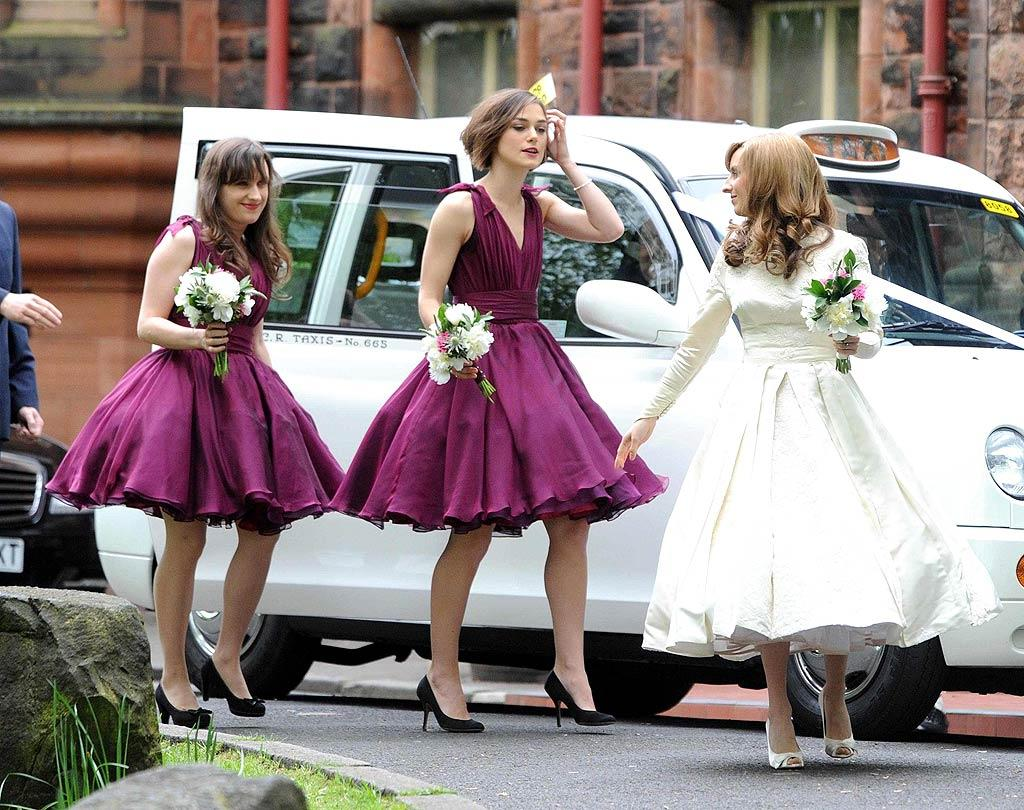 "Always a bridesmaid, never a bride! While the rest of the world was gearing up for the royal wedding, actress Keira Knightley took part in her brother Caleb's nuptials to designer Kerry Nixon, in Glasgow, Scotland, on Tuesday. The 26-year-old donned a flouncy purple bridesmaid frock for the occasion. Mirrorpix/<a href=""http://www.splashnewsonline.com"" target=""new"">Splash News</a> - April 26, 2011"