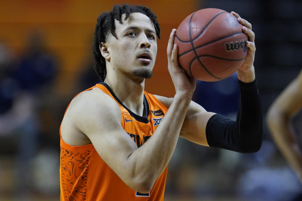 FILE - Oklahoma State guard Cade Cunningham is shown during an NCAA college basketball game against Oral Roberts in Stillwater, Okla., in this Tuesday, Dec. 8, 2020, file photo. Cunningham has made The Associated Press All-America first team, announced Tuesday, March 16, 2021. (AP Photo/Sue Ogrocki, File)