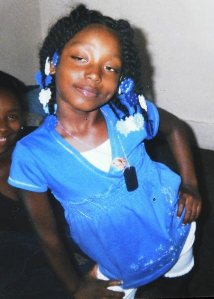 FILE - This undated file family photo shows Aiyana Stanley-Jones, 7, who was shot and killed May 16, 2010, by a shot from a Detroit police officer during a raid of a Detroit home in search of a murder suspect. Jury selection is beginning in the trial of a Detroit police officer charged with involuntary manslaughter in the death of Stanley-Jones, who was fatally shot while she slept on a couch during the raid. (AP Photo/Family Photo via The Detroit News) DETROIT FREE PRESS OUT; HUFFINGTON POST OUT