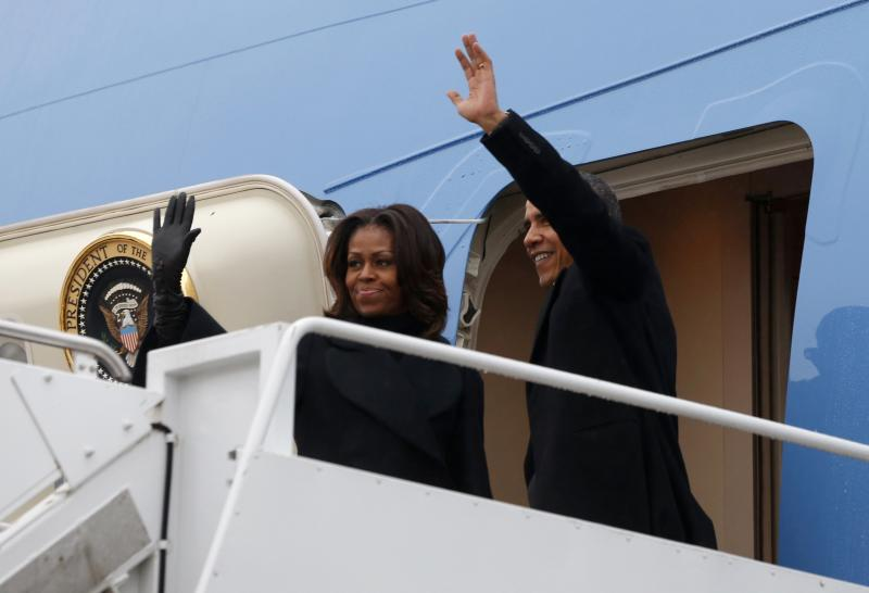 U.S. President Barack Obama and first lady Michelle Obama depart Joint Base Andrews in Washington en route to Johannesburg December 9, 2013. Obama will attend the memorial service for South Africa's Nelson Mandela on Tuesday. Mandela, South Africa's first black president who steered his nation out of apartheid and into multi-racial democracy, died on Thursday at the age of 95 after months of illness.