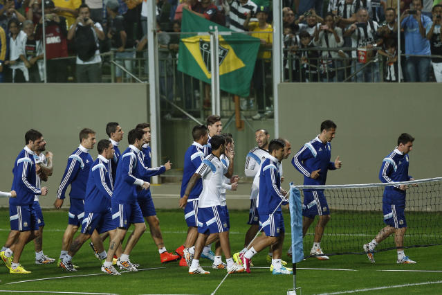 The Argentine national soccer team runs during a training session at Independencia Stadium in Belo Horizonte, Brazil, Wednesday, June 11, 2014. Argentina will play in group F of the Brazil 2014 soccer World Cup. (AP Photo/Victor R. Caivano)