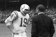 FILE - In this Sept. 26, 1965, file photo, Baltimore Colts quarterback John Unitas confers with coach Don Shula on the sidelines in the final minutes of a football game against the Green Bay Packers at County Stadium in Milwaukee. The tough luck team of the decade might have been the Baltimore Colts. (AP Photo/File)