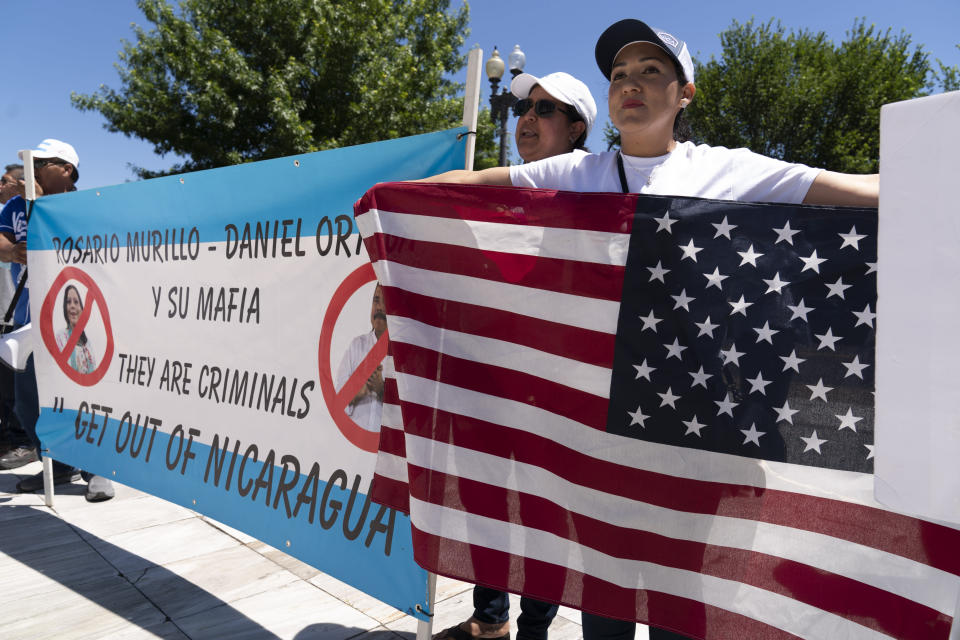 Nicaragua supporters protest outside of the Organization of the American States asking to free political prisioners and stop the government's human rights violations against critics, during a rally in Washington, Wednesday, June 23, 2021. (AP Photo/Jose Luis Magana)