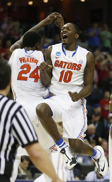 Florida's Casey Prather (24) Dorian Finney-Smith (10) celebrate after the second half in a regional final game against Dayton at the NCAA college basketball tournament, Saturday, March 29, 2014, in Memphis, Tenn. Florida won 62-52. (AP Photo/John Bazemore)