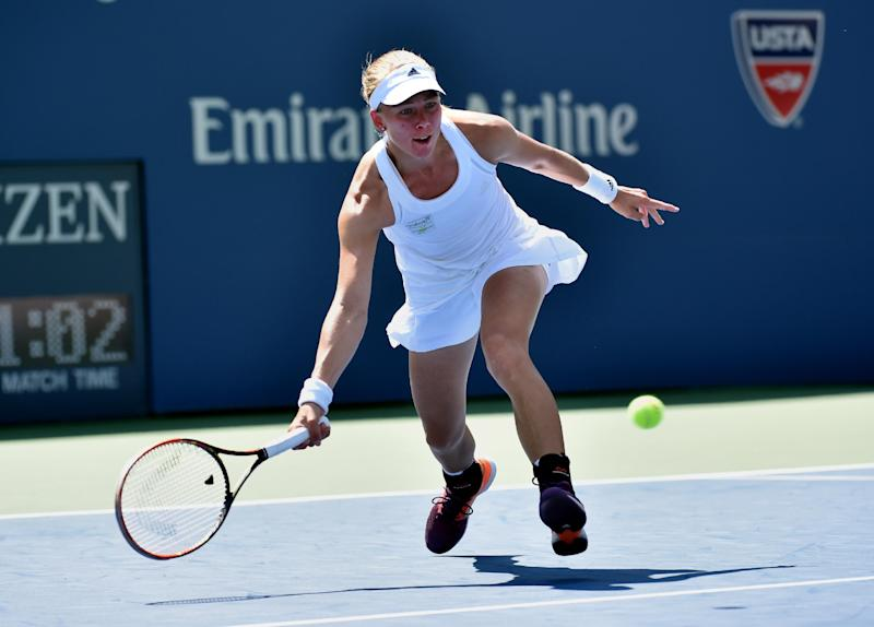 Johanna Larsson of Sweden returns a shot to Sloane Stephens of the US during their 2014 US Open women's singles match on August 27, 2014 in New York (AFP Photo/Stan Honda)