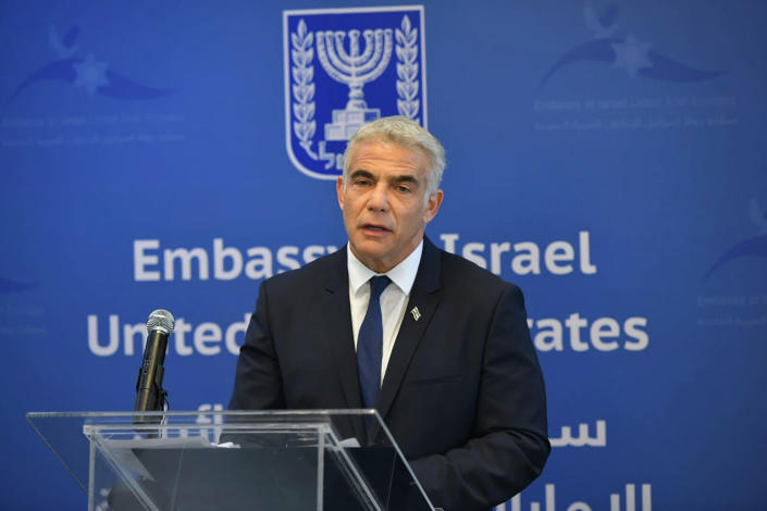 In this photo made available by the Israeli Government Press Office, Israeli Foreign Minister Yair Lapid speaks during the inauguration of the Israeli Embassy in Abu Dhabi, United Arab Emirates, Tuesday, June 29, 2021. Israel's new foreign minister is in the UAE on the first high-level trip by an Israeli official to the Gulf Arab state since the two countries normalized relations last year. (Shlomi Amsalem/Government Press Office via AP)