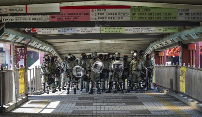 Riot police on a footbridge in Hung Hom, near Polytechnic University campus. Photo: Roy Issa