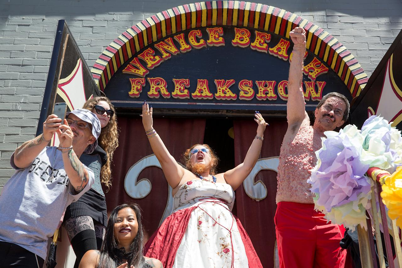 """Performers """"Wee Matt"""" McCarthy, Kanya, Sunshine and """"Jessa the Bearded Lady"""" Holmstead and """"Bob the Bubble Boy"""" Heslip are seen during the Venice Beach Freakshow final performance and rent rise protest party on Venice Beach, Los Angeles, California, U.S., April 30, 2017. REUTERS/Monica Almeida"""