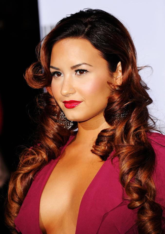 <p>Demi Lovato debuted her new red ombré hair at the 2011 Latin Grammys, styling it in long barrel curls and complementing it with minimal eye makeup, pink cheeks, and bright red lips. </p>