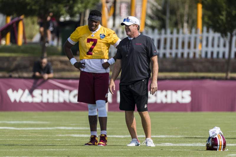 RICHMOND, VA - JULY 26: Head coach Jay Gruden of the Washington Redskins speaks with Dwayne Haskins #7 during training camp at Bon Secours Washington Redskins Training Center on July 26, 2019 in Richmond, Virginia. (Photo by Scott Taetsch/Getty Images)
