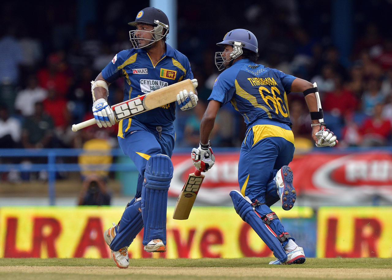 Sri Lankan cricketers Lahiru Thirimanne (R) and Kumar Sangakkara take a single during the fifth match of the Tri-Nation series between Sri Lanka and West Indies at the Queen's Park Oval in Port of Spain on July 7, 2013. West Indies won the toss and elected to field. AFP PHOTO/Jewel Samad        (Photo credit should read JEWEL SAMAD/AFP/Getty Images)