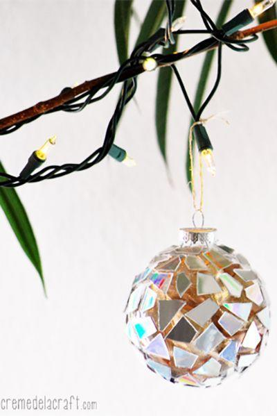 """<p>We all have some scratched or broken CDs lying around, so put them to good use by adorning a set of inexpensive clear bulbs with its pieces. It's a savvy way to save money on craft supplies while adding some sparkle and shine to your Christmas tree.</p><p><strong>Get the tutorial at <a href=""""http://www.cremedelacraft.com/2012/11/DIYOrnaments.html?m=1"""" rel=""""nofollow noopener"""" target=""""_blank"""" data-ylk=""""slk:Creme de la Craft"""" class=""""link rapid-noclick-resp"""">Creme de la Craft</a>.</strong></p><p><a class=""""link rapid-noclick-resp"""" href=""""https://www.amazon.com/Creative-Hobbies-Round-Plastic-Ornaments/dp/B00EA27NYU/?tag=syn-yahoo-20&ascsubtag=%5Bartid%7C10050.g.1070%5Bsrc%7Cyahoo-us"""" rel=""""nofollow noopener"""" target=""""_blank"""" data-ylk=""""slk:SHOP CLEAR PLASTIC ORNAMENTS"""">SHOP CLEAR PLASTIC ORNAMENTS</a></p>"""