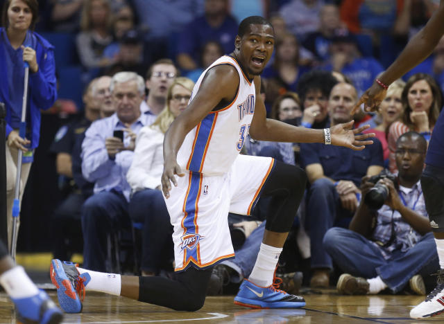 Oklahoma City Thunder forward Kevin Durant gestures to an official during the first quarter of an NBA basketball preseason game against the New Orleans Pelicans in Tulsa, Okla., Thursday, Oct. 17, 2013. (AP Photo/Sue Ogrocki)