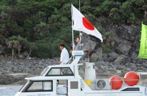 A boat, part of a 20-boat flotilla carrying activists and lawmakers including Japanese nationalists, arrives at a group of disputed islands known as Senkaku in Japan and Diaoyu in China, on August 19