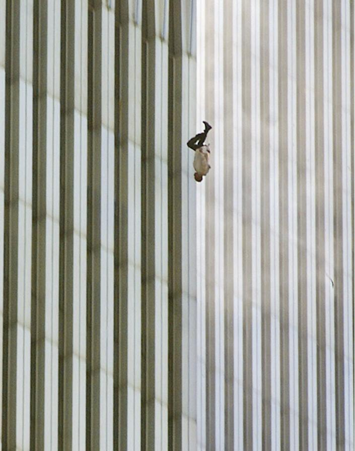 """In a scene repeated with terrifying frequency as flames engulfed the top of the towers, a man falls (or leaps, as was evidently the case with many victims) to his death from the World Trade Center. On the morning of September 11 photographer Richard Drew, in the midst of another assignment, got the call to drop everything and head to the World Trade Center. As soon as he arrived downtown he began shooting; later in the day, as as he processed what he had shot, he was especially struck by this photo -- and with reason. One of the most recognizable pictures made on 9/11, the image from a purely photographic perspective is breathtaking: the miniscule human form caught against the massive, abstract background of the towers is so obviously helpless, and doomed, that we're tempted to reach out our hands to try and cradle the tiny anonymous figure. And while Drew himself refuses to conjecture about the man's identity (""""I prefer to think of him as a sort of Unknown Soldier,"""" he told LIFE.com), it's impossible not to put ourselves in the falling man's place -- with all the dread and empathy that that sort of transference commands. <br><br>(Photo: AP Photo/Richard Drew)<a href=""""http://www.life.com/gallery/59971/911-the-25-most-powerful-photos#index/0"""" rel=""""nofollow noopener"""" target=""""_blank"""" data-ylk=""""slk:"""" class=""""link rapid-noclick-resp""""><br></a>"""