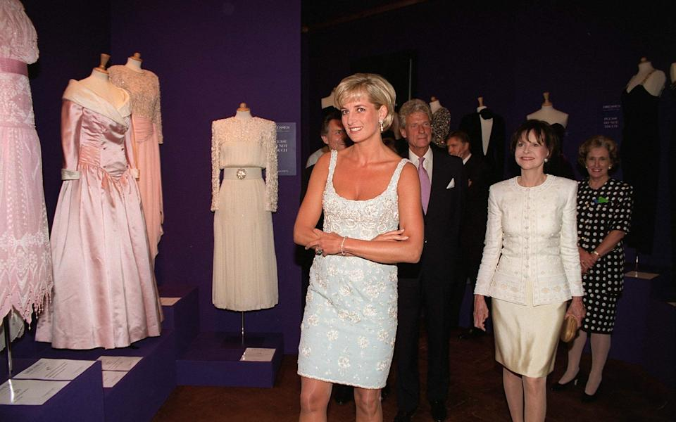 With Diana, Princess of Wales, at a charity auction in 1997 - Tim Graham Photo Library via Getty Images