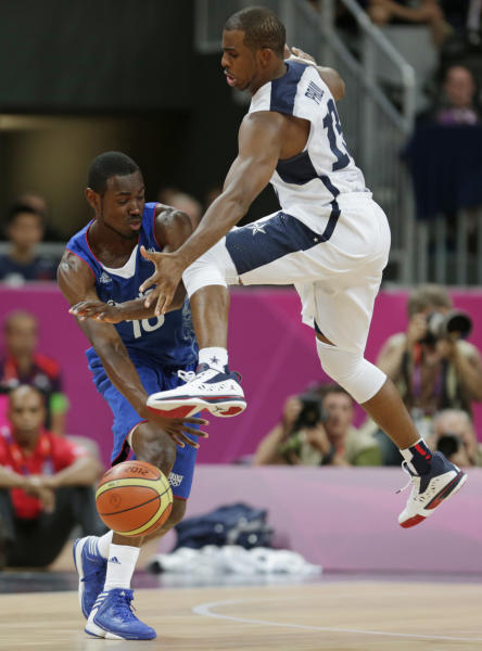 France's Yannick Bokolo drives against United States' Chris Paul during the first half of a preliminary men's basketball game at the 2012 Summer Olympics, Sunday, July 29, 2012, in London. (AP Photo/Charles Krupa)