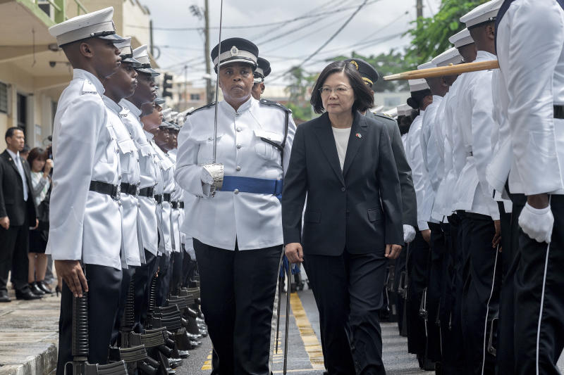 "In this photo released by the Taiwan Presidential Office, Taiwanese President Tsai Ing-wen attends a welcome ceremony in St. Lucia on Thursday, July 18, 2019. Tsai said she would follow ""humanitarian principles"" in dealing with asylum seekers from Hong Kong during a visit this week to Saint Lucia, an eastern Caribbean island nation that is among Taiwan's few remaining allies. (Taiwan Presidential Office via AP)"