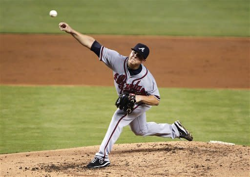 Atlanta Braves' Kris Medlen delivers a pitch during the second inning of a baseball game against the Miami Marlins, Wednesday, Sept. 19, 2012, in Miami. (AP Photo/Wilfredo Lee)