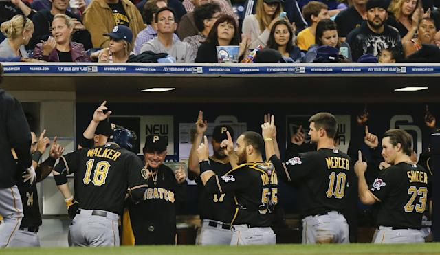Pittsburgh Pirates' Neil Walker returns to the Pirates dugout after his two-run home run against the San Diego Padres in the third inning of a baseball game Tuesday, June 3, 2014, in San Diego. (AP Photo/Lenny Ignelzi)
