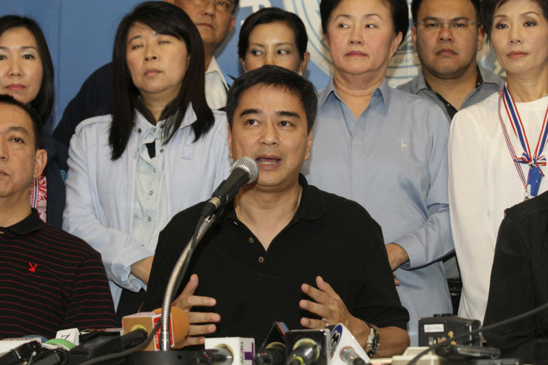 """Democrat leader and former Prime Minister Abhisit Vejjajiva speaks along with his party members during a press conference in Bangkok, Thailand, Sunday, Dec. 8, 2013. The main opposition party announced it was resigning from parliament to protest what it called """"the illegitimacy"""" of the government. The move deepens the country's latest political crisis a day before new street demonstrations that many fear could turn violent. (AP Photo/Sakchai Lalit)"""