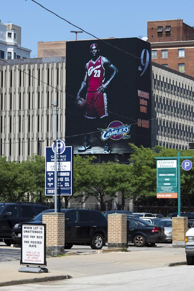 CLEVELAND, OH - JULY 11: A few hours after announcing his return to Cleveland an image of Lebron James is displayed on a billboard in downtown Cleveland on July 11, 2014 in Cleveland, Ohio (Photo by Angelo Merendino/Getty Images)