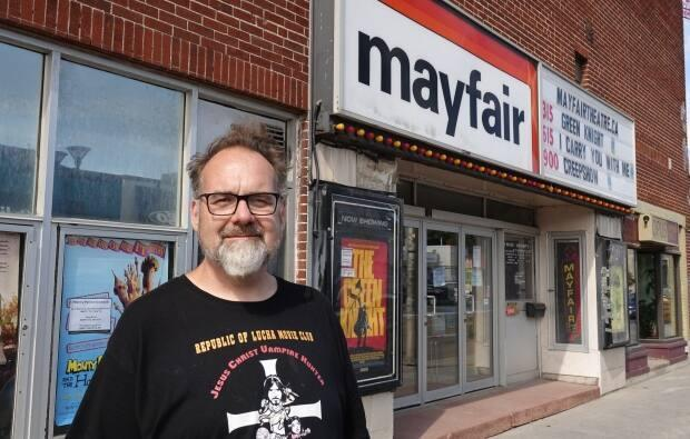 Lee Demarbre, owner of the Mayfair Theatre, says any talk of redeveloping the building housing his cinema flies in the face of the City of Ottawa's heritage designation of the building's exterior and interior. (Giacomo Panico/CBC - image credit)
