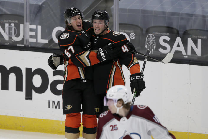 Anaheim Ducks center Rickard Rakell, left, celebrates scoring a goal with defenseman Andy Welinski during the second period of an NHL hockey game against the Colorado Avalanche in Anaheim, Calif., Sunday, Jan. 24, 2021. (AP Photo/Alex Gallardo)