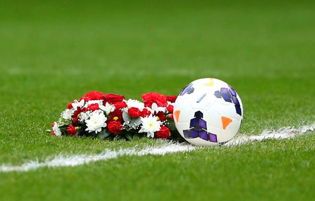 SUNDERLAND, ENGLAND - APRIL 12: A floral wreath is laid on the pitch to mark the 25th anniversary of the Hillsborough disaster prior to the Barclays Premier League match between Sunderland and Everton at Stadium of Light on April 12, 2014 in Sunderland, England. (Photo by Alex Livesey/Getty Images)