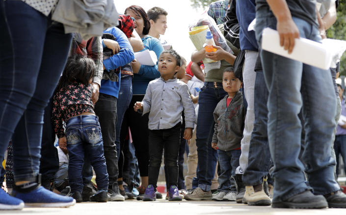 Immigrant families line up to enter bus station after being processed and released by U.S. Customs and Border Protection on June 24, 2018, in McAllen, Texas. (Photo: David J. Phillip/AP)