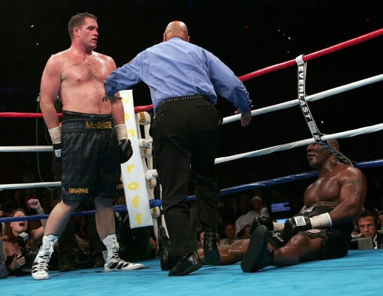 Mike Tyson is downed by Kevin McBride in his last professional bout in 2005. The former heavyweight world champion takes on Roy Jones Jr in an exhibition fight next month