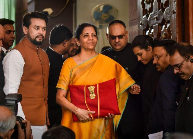 Sitharaman with the 'budget' within the device under the red cloth