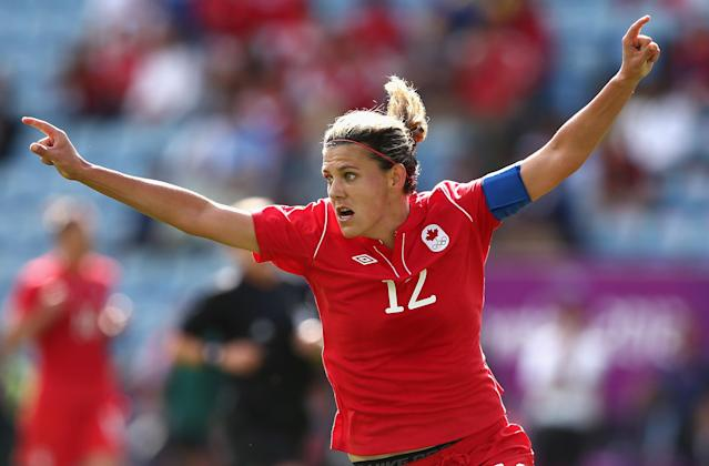 COVENTRY, ENGLAND - JULY 28: Christine Sinclair of Canada celebrates scoring a goal during the Women's Football first round Group F Match of the London 2012 Olympic Games between Canada and South Africa,>> at City of Coventry Stadium on July 28, 2012 in Coventry, England. (Photo by Quinn Rooney/Getty Images)