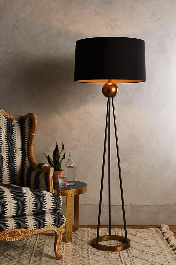 "<p><a href=""https://www.elledecor.com/shopping/home-accessories/g1124/the-top-10-floor-lamps/"" target=""_blank"">Floor lamps</a> are always a stylish addition, but this industrial black-and-bronze piece is impossibly chic.<br></p><p><em>$1,098, Anthropologie</em></p><p><a class=""body-btn-link"" href=""https://go.redirectingat.com?id=74968X1596630&url=https%3A%2F%2Fwww.anthropologie.com%2Fshop%2Ftriangulate-floor-lamp-ensemble2%3Fcategory%3Dlighting%26color%3D070&sref=http%3A%2F%2Fwww.elledecor.com%2Fshopping%2Fhome-accessories%2Fg10395925%2Fmodern-lighting%2F"" target=""_blank"">Buy Now</a></p>"